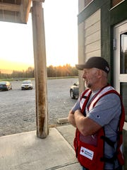 Red Cross volunteer and retired educator Matt Clark awaits evacuees of the McKinley Fire at the Upper Susitna Senior Center in Sunshine, Alaska, as the sun set Saturday night.
