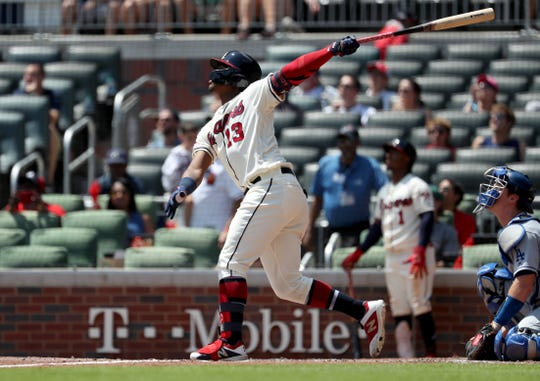 Ronald Acuña Jr. watches the ball he hit off the center field wall on Sunday against the Dodgers. He didn't run hard out of the batter's box and only wound up with a single.