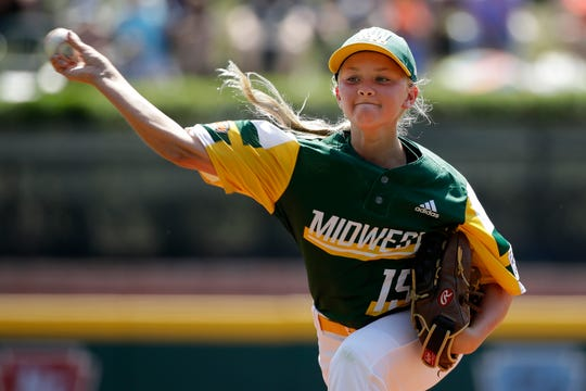 Coon Rapids, Minnesota's Maddy Freking delivers during the third inning of a baseball game against South Riding, Virginia at the Little League World Series tournament.