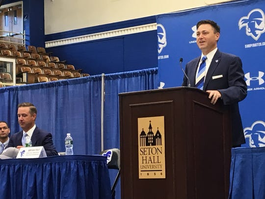 New Seton Hall Athletics Director Bryan Felt (center) speaks at his introductory press conference with senior vice president (left) Pat Lyons next to him.