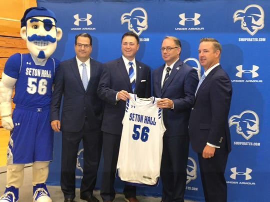 New Seton Hall Athletics Director Bryan Felt (center) with Seton Hall Board of Regents official Hank D'Alessandro, president Joseph Nyre and senior vice president Pat Lyons.