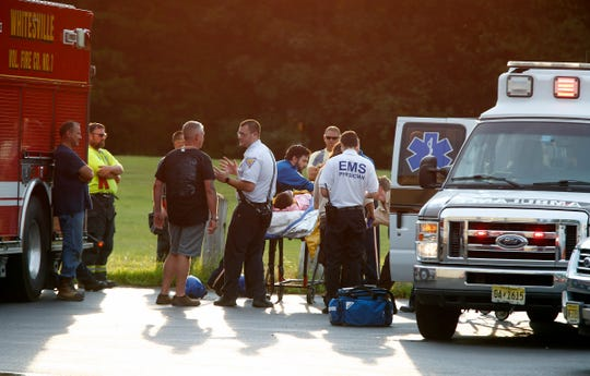 Emergency personnel prepare a child for a medevac flight Monday afternoon after a car they were in was involved in a collision along Toms River Road in Jackson Township.