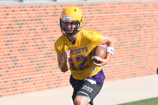 Hardin-Simmons quarterback Brennen Wooten (12) carries the ball in a drill during the first practice of fall camp at Shelton Stadium in August.