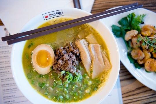 The Itto Curry Ramen at Itto Ramen Bar and Tapas is yellow curry broth with house-made ramen noodles, ground pork, a seasoned boiled egg, bamboo shoots and scallions.