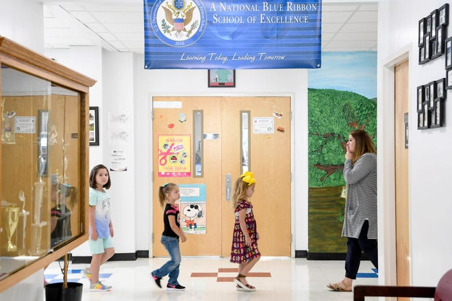 Pisgah Elementary students quietly walk down the hall with their teacher on the first day of school August 19, 2019.
