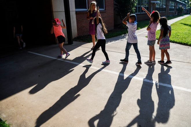 Candler Elementary students walk to class on the first day of school August 19, 2019.