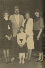 """James """"Dedrick"""" Brown stands beside his wife Sharon and daughters Tina, Tammy and Tara in a photo used during his 1986 campaign for sheriff."""