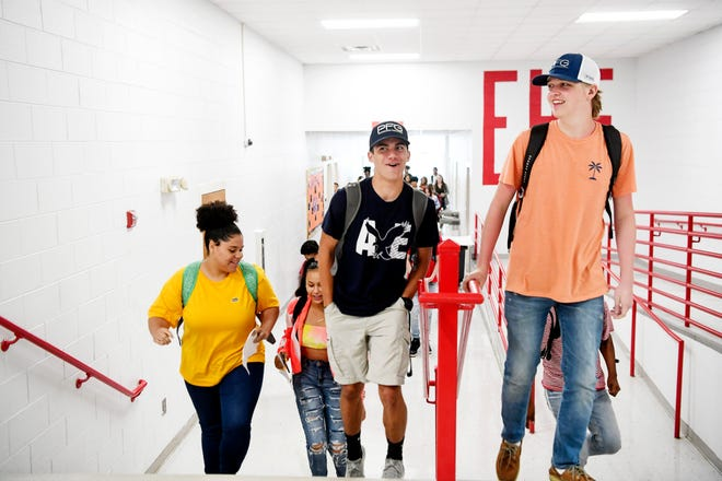 Erwin High School students change classes on the first day of school August 19, 2019.
