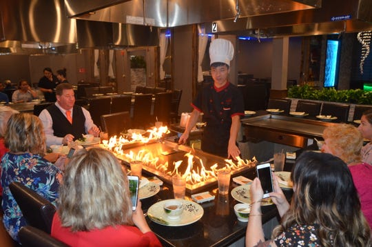 A chef from Kume Hibachi & Steakhouse addresses the table before beginning his cooking on their opening day.