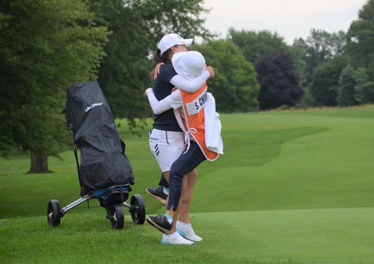 Ssu-Chia Cheng get a hug from her mother, who is also her caddie, after the winning the 2019 FireKeepers Casino Hotel Golf Championship Sunday at Battle Creek Country Club