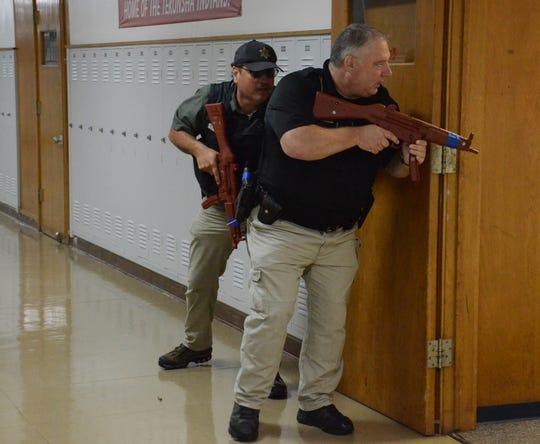 Deputies Dan Hilman, front, and Matt Madsen search for a gunman during training Monday.