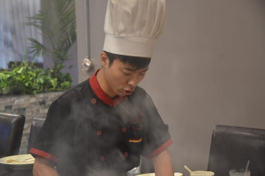 Chefs at Kume Hibachi & Steakhouse cook the dishes in front of the customers.