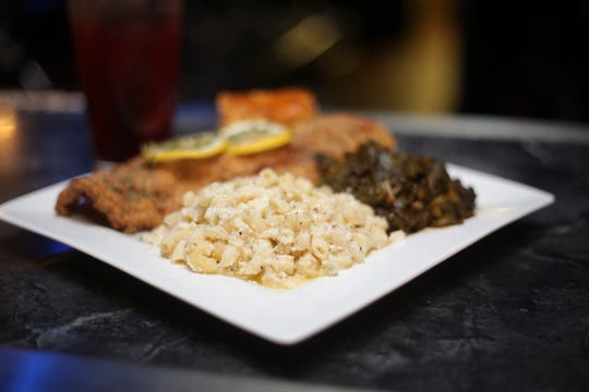 A catfish meal is served with sides of baked macaroni and cheese, and collard greens at Muffer's Kitchen.