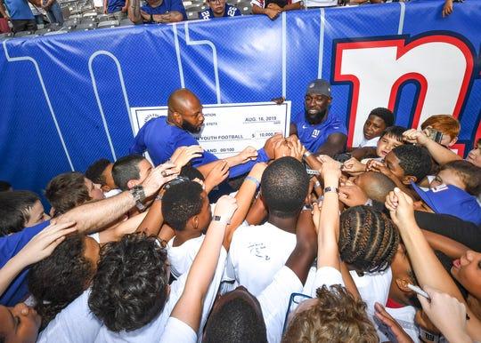 New York Giants players Antoine Bethea and Michael Thomas met with members the City of Binghamton's tackle football program on Aug. 16, 2019.
