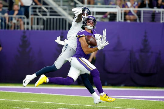 Minnesota Vikings wide receiver Adam Thielen, front, tries to make a reception in front of Seattle Seahawks cornerback Tre Flowers, back, during the first half of an NFL preseason football game, Sunday, Aug. 18, 2019, in Minneapolis. Flowers was called for pass interference on the play.