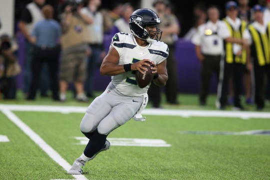 Seattle Seahawks quarterback Russell Wilson throws a pass during the first half of an NFL preseason football game against the Minnesota Vikings, Sunday, Aug. 18, 2019, in Minneapolis.