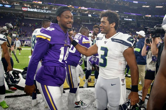Minnesota Vikings wide receiver Stefon Diggs talks with Seattle Seahawks quarterback Russell Wilson (3) after an NFL preseason football game, Sunday, Aug. 18, 2019, in Minneapolis. The Vikings won 25-19.
