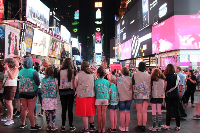 Ten girls from Black Mountain Girl Scout Troop 02498 take in the bright lights of Times Square during their trip to New York City.