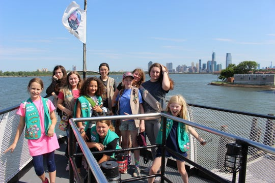 Ten Cadettes and Seniors of Black Mountain Girl Scout Troop 02498 catch a ferry to Ellis Island to see the Statue of Liberty during their trip to New York City.