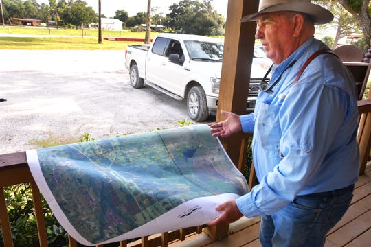 Billy Kempfer, a fourth-generation rancher, has allowed biosolids to be spread on some of his pastures in Brevard and Osceola counties. Kempfer shows on a map the pastures that have biosolids spread on them.