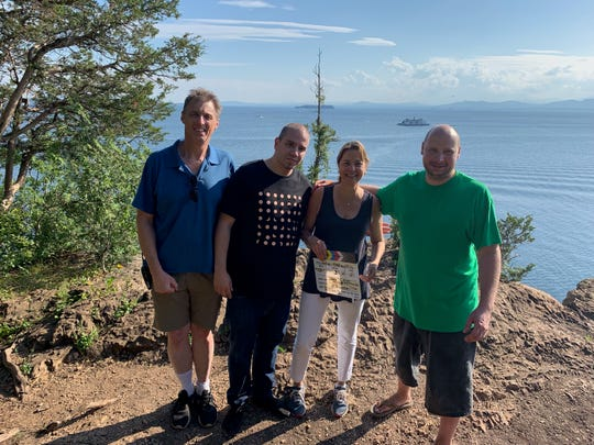 "From left, Verde Group Films Executive Producer Denis O'Brien, ""Zodiac"" director and writer Alex Zinzopoulos, Executive Producer Janet Morris, and writer and director Jack Skyyler pose at Lone Rock Point in Burlington where they began filming a pilot for ""Zodiac"" in August 2019."
