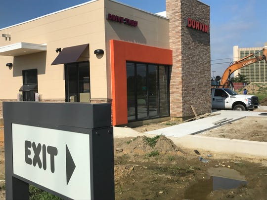 Workers are nearing completion of a Dunkin' restaurant on eastbound Route 70 in Cherry Hill.
