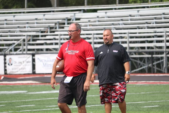 Third-year head coach Pat McLaughlin (left) directs La Salle's intrasquad scrimmage on Saturday, Aug. 10, 2019 at Lancer Stadium. McLaughlin is 14-8 in his two years at La Salle.