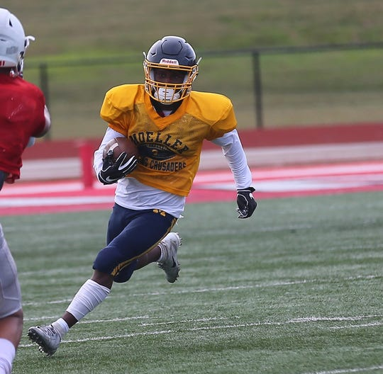 Moeller wide receiver Brandon White runs the ball during their scrimmage against Colerain, Saturday, Aug. 19,2019.