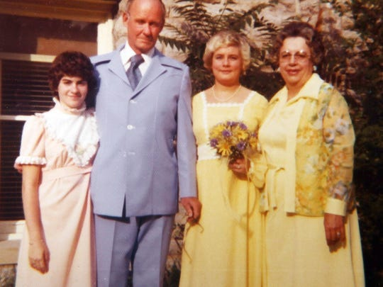 Cary Camm (left) stands with her sister, Diane, and their parents, Bill and Mildred Camm, on Diane's wedding day, May 22, 1977.