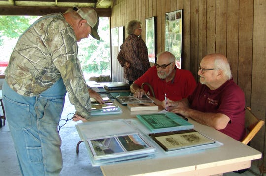 Dave Snyder, seated, front, shares history with visitors during the 152nd G.A.R. Bean Dinner at McElwee Park in New Castle.