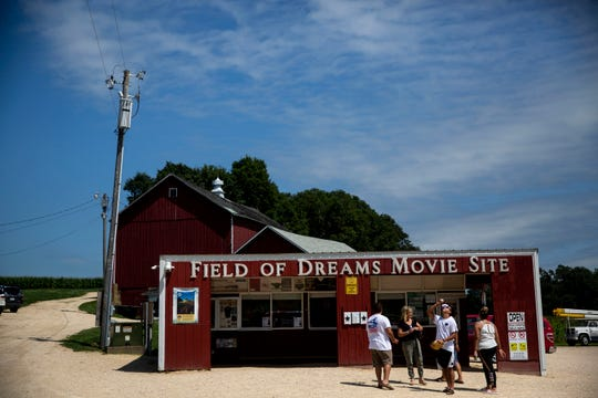 "Tourists visit the ""Field of Dreams"" movie site on Monday, Aug. 19, 2019, in Dyersville. While the movie site is a big draw for tourists, other attractions in towns along U.S. Highway 20 could benefit from an effort that would place more than 100 historic markers along the entire 333 miles of the highway in Iowa."