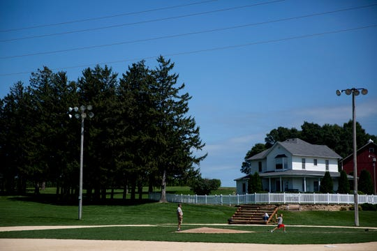 Tourists visit the Field of Dreams one year before the White Sox and the Yankees will play on a stadium being built next to the field, on Monday, Aug. 19, 2019, in Dyersville.