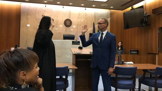 Oakland County Circuit Court Judge Shalina Kumar swears in David Coulter as the new Oakland County executive on Aug. 19, 2019 in her courtroom.
