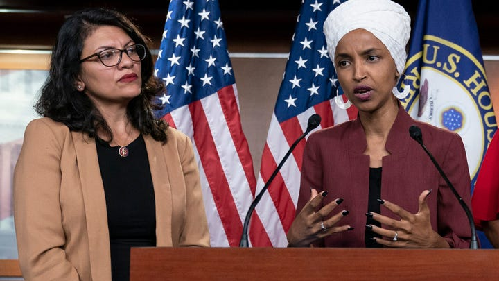 In this July 15, 2019, file photo, U.S. Rep. Ilhan Omar, D-Minn, right, speaks, as U.S. Rep. Rashida Tlaib, D-Mich. listens, during a news conference at the Capitol in Washington.