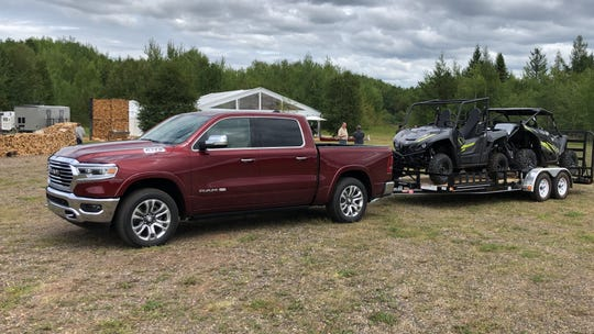The 2020 Ram 1500 diesel can tow up to 12,560 pounds. The trailer pictured weighs about 5,150.