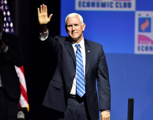 Vice President Mike Pence waves to the crowd after his speech during the Detroit Economic Club luncheon at the Sound Board Theater at MotorCity Casino in Detroit Monday.
