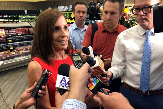 Sen. Martha McSally, R-Ariz., speaks to reporters about guns following a visit to a grocery store pharmacy in Phoenix, Thursday. McSally and other Republicans looking ahead at tough races increasingly are looking for new ways to address anxieties about gun violence _ without running crosswise from a GOP base that sees gun restrictions as an infringement on the constitutional right to bear arms.