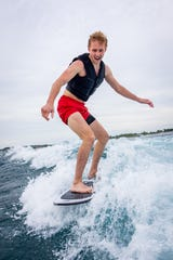 Jake Tasker of Buffalo, NY attempts wake surfing for the first time on Lake Michigan.