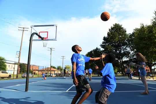 Maleke Prude, 12, right, and Alijah Robinson, 10, play during a Basketball for All Neighbors Program at Delores Bennett Park in Detroit on Aug. 15, 2019. This is week five of a six week program sponsored by the Pistons, who are on track to restore 15 courts at 8 parks this summer, as part of its community benefits commitment for the Pistons Performance facility.