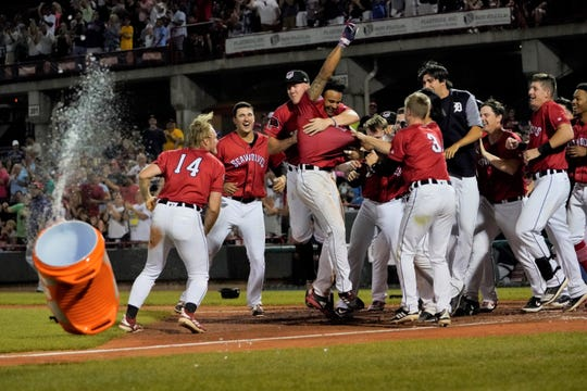 Erie SeaWolves outfielder Derek Hill (11) is mobbed by his teammates at home plate after hitting a two-run walk-off homerun in the 10th inning to beat the Binghamton Rumble Ponies 4-3 on July 3.