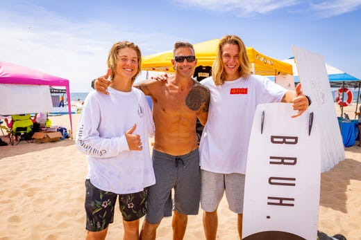 Brian LeFeve, owner of Great Lakes Surf Shop in St. Clair Shores is flanked by Nicholas Cobb, left, and Daniel Cobb, co-founders of Bruh, an apparel and board brand. The Cobb brothers see LeFeve as a mentor and friend who got them into water sports.