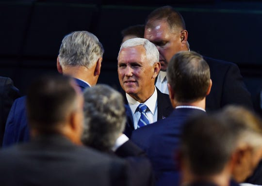 Vice President Mike Pence greet guests after his speech during the Detroit Economic Club luncheon at the Sound Board Theater at MotorCity Casino in Detroit Monday.
