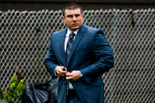 "In this May 13, 2019, file photo New York City police officer Daniel Pantaleo leaves his house Monday, May 13, 2019, in Staten Island, N.Y. After five years of investigations and protests, New York City's police commissioner on Monday, Aug. 19, fired Pantaleo, an officer involved in the 2014 chokehold death of an unarmed black man whose dying cries of ""I can't breathe"" fueled a national debate over race and police use of force."