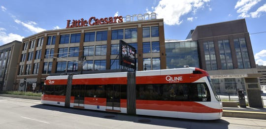 A QLine Detroit streetcar departs the Sproat Street station