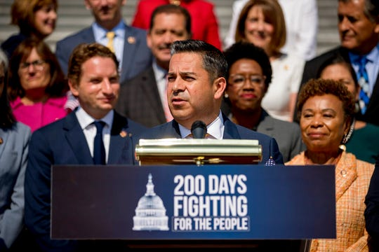 In this July 25, 2019, file photo, Rep. Ben Ray Lujan, D-N.M., center, speaks as House Democrats hold a news conference in Washington. Luján has become the highest-ranking Democrat in the House to call for an impeachment inquiry against President Donald Trump, saying it's time to hold him accountable.