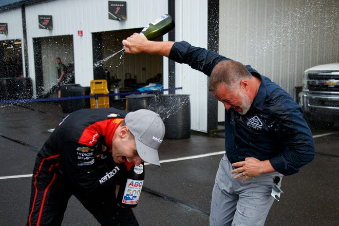 Will Power, left, celebrates with Pocono Raceway's Nick Igdalsky after winning an IndyCar Series auto race Sunday at Pocono in Long Pond, Pa.