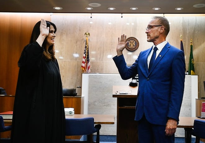 Former Ferndale Mayor Dave Coulter is sworn in as Oakland County executive by Chief Judge Shalina Kumar at Oakland County Circuit Court in Pontiac on Monday.