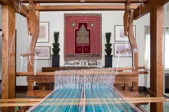 "A 1936 Cranbrook loom frames ""Cranbrook Rug No. 1,"" Studio Loja Saarinen's first creation."