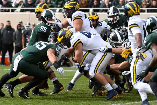 The Wolverines are ranked No. 7, while the Spartans are No. 18 in the preseason Associated Press college football poll, released Monday.