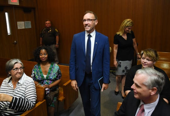 Dave Coulter arrives at the courtroom of Chief Judge Shalina Kumar in Pontiac Monday to be sworn in as Oakland County Executive, a position vacated by the death of L. Brooks Patterson.
